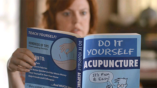 Woman with book about acupuncture