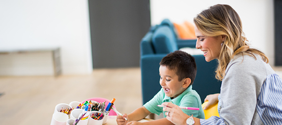 Mother and son coloring together