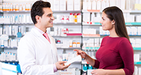 pharmacist giving scripts to patient