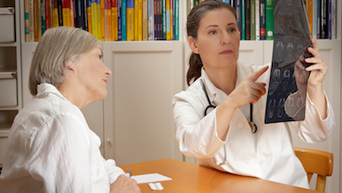 Woman conferring with her doctor