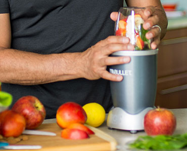 man using a nutribullet