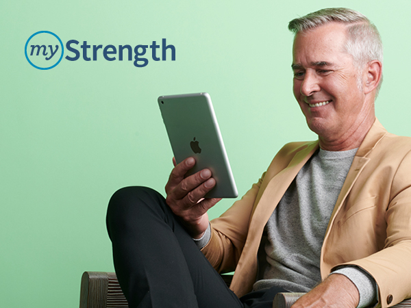 myStrength logo and smiling older man in a tan jacket looking at a tablet