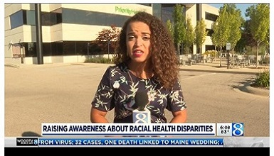 reporter standing in front of Priority Health offices