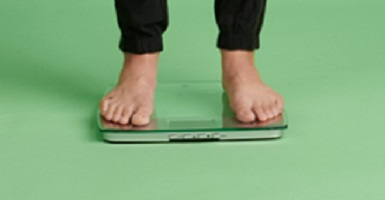 Pair of feet standing on a scale