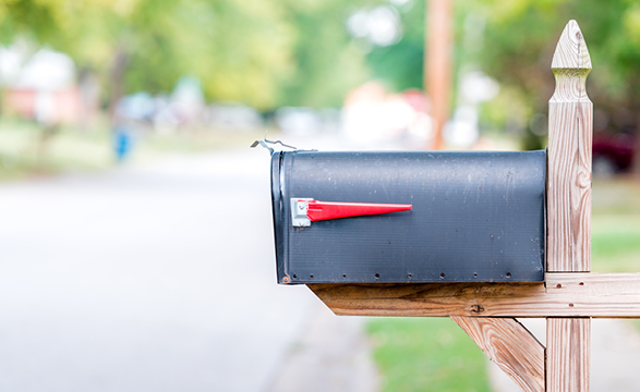 image of a mailbox next to a road