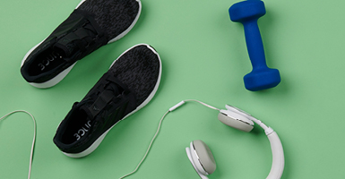 running shoes, headphones and dumbbells
