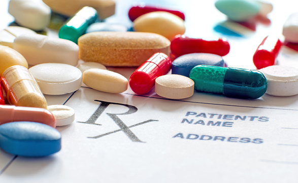 image of scattered prescription pills on an rx form